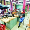 Ticonderoga High School technology instructor Robert Palandrani Sr. sits in his new 5,000-square-foot shop. The Corvette at left is part of a project the students are working on this year. <br><br>(Staff Photo/Lohr McKinstry)
