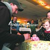 Cory and Yondel Gearhart watch as their 3-year-old daughter, Savannah, opens a present she received during a benefit dart tournament and turkey dinner at the American Legion Post 1619 in West Plattsburgh Saturday afternoon to raise funds for her travel expenses to help combat a rare syndrome she acquired called cri du chat.<br><br>(P-R Photo/Gabe Dickens)