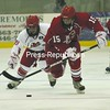 The Red Team's Dan Sliasis (15) carries the puck as the White Team's Jared Docking (39) pursues during Plattsburgh State's recent Annual Red/White Game at the Stafford Ice Arena. The Cardinals play Montreal's Concordia in an exhibition tonight at 7 p.m.<br><br>(P-R Photo/Gabe Dickens)