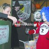"""Lauren Semione (left) looks on as Chandler LaFountain, 6, of Keesville receives candy at the """"Trick or Treat on Safety Street"""" at the Crete Memorial Civic Center in Plattsburgh Friday evening. Chandler's brother Anthony, 6, waits patiently behind him for his turn. Booths made up as houses provided a controlled """"neighborhood"""" for trick-or-treating. Area businesses sponsored each house, which were painted by the City of Plattsburgh Recreation Department. <br><br>(P-R Photo/Andrew Wyatt)"""