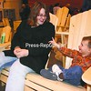 Patricia Bull and her little brother, Jonathon St. Lewis of Plattsburgh, relax on one of Jim Dugan's Adirondack pine chairs after perusing the many wares at the Plattsburgh State Arts and Crafts Fair over the weekend. Many of the approximately 140 vendors reported doing better than last year at the annual two-day fair.<br><br>(Staff Photo/Alvin Reiner)