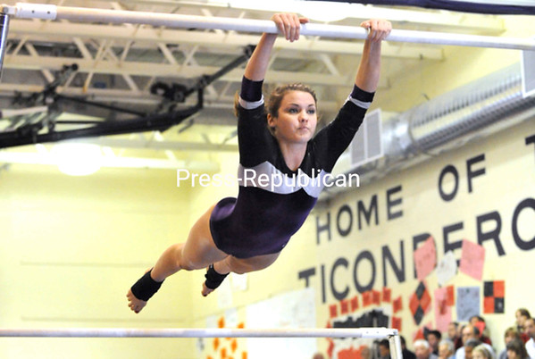 Ticonderoga's Joann Campbell swings through her uneven parallel bars routine.<br><br>(P-R Photo/Pat Hendrick)