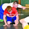 Franklin Academy wrestling coach Nathaniel Hathaway demonstrates a technique with help from Ross Barber during preseason practice last week.<br><br>(P-R Photo/Pat Hendrick)