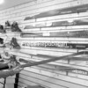 Nick Labonte, co-owner of the Wooden Ski and Wheel, points out that some cross-country skis for sale in the Plattsburgh store have both ceramic and metal edges. <br><br>(P-R Photo/Andrew Wyatt)