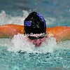 Peru's Molly Wilkins glides through the water on her way to victory Saturday in the 100-yard butterfly at Plattsburgh State. Wilkins helped the Indians successfully defend their Section VII swimming title.<br><br>(P-R Photo/Gabe Dickens)