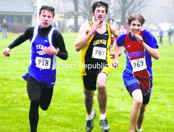 Josh Romanowicz of Peru, Mike Saulpaugh of Lake Placid and Sean Connors of Ausable Valley race to the finish line.   <br><br>(Staff Photo/Alvin Reiner)