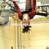 Beekmantown's Alyssa Leonard looks down for her landing spot on the balance beam.<br><br>(P-R Photo/Pat Hendrick)