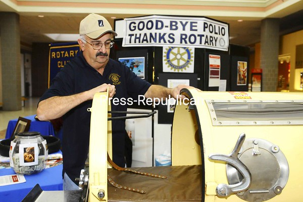 Chateaugay Rotary member Don Bilow opens an Iron Lung, which was used to assist polio patients with breathing. Since 1979, Rotary International has helped raise funds to vaccinate children all over the world against the disease, which has almost been eradicated in the United States.<br><br>(Staff Photo/Kelli Catana)