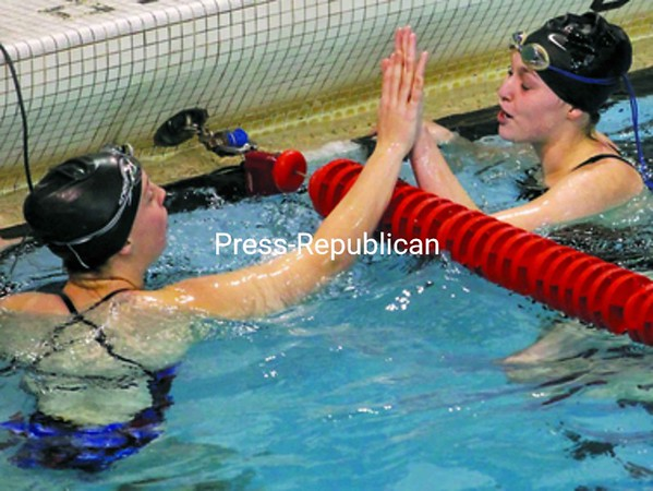 Plattsburgh High's Cara Sorensen (right) gets congratulations for winning the 50-yard freestyle from AuSable Valley's Alexis Facteau Saturday during the Section VII swimming championships at Plattsburgh State.<br><br>(P-R Photo/Gabe Dickens)