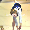 Peru's Karsyn O'Donnell reaches for the balance beam as she performs a walkover. Coach Ashley Lamoy watches in the background.<br><br>(P-R Photo/Pat Hendrick)