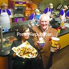 Franchise owners Sueayn and Phillip Wood present an entree and dessert at the new Moe's Southwest Grill in Plattsburgh Wednesday evening.<br><br>(P-R Photo/Andrew Wyatt)