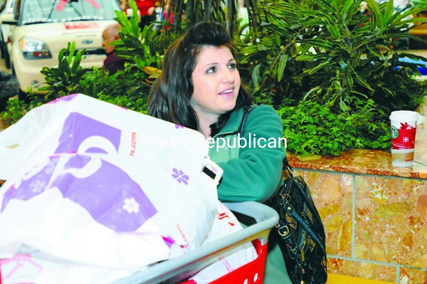 Elizabeth Marshall of Malone rested at Champlain Centre mall on Black Friday after finding a cart full of Christmas presents. She said the crowds weren't as packed as years past but that the deals couldn't be missed.<br><br>(Staff Photo/Kelli Catana)