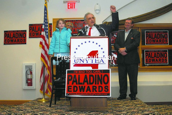 Republican candidate for governor Carl Paladino is joined by Maggie Meyer, 7, of Jay; UNYTEA leader Mark Barie; and Dave Kimmel, candidate for the State Assembly; as Paladino campaigned at the Westside Ballroom in Plattsburgh Friday evening.<br><br>(P-R Photo/Andrew Wyatt)