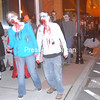 Lyndsey and John Banker of Schuyler Falls stumble down City Hall Place Saturday evening during the Zombie Walk. The  hrong of costumed participants ended the Halloween-themed event  n the campus of Plattsburgh State.<br><br>(P-R Photo/Andrew Wyatt)