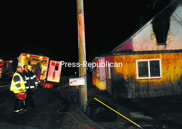 Fire destroyed an upstairs bedroom at 4432 Route 11 in Mooers Wednesday evening. Mooers, Ellenburg Depot, Altona and Champlain fire departments and Champlain EMS responded, while Churubusco was on standby. See story, page A6.<br><br>(Staff Photo/Kelli Catana)
