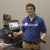 Adam Picerno, the home essentials specialist at Best Buy in Plattsburgh, holds two of the store's hot Christmas gift items, the Move game controller for Playstation 3 and the XBox Kinect, a-controller-free device for its video game system.<br><br>(P-R Photo/Andrew Wyatt)