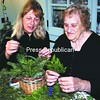 Mary Fielder and her mother, Huberta Conway, work on festive baskets to be sold at the annual Greens Tea held by the Elizabethtown-Lewis Garden Club.<br><br>(Staff Photo/Alvin Reiner)