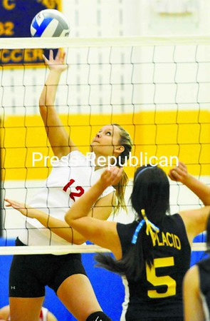 Braquel Campion of Saranac drives the ball past Brianna Wyle in the first game of a CVAC volleyball match Friday in Lake Placid. Saranac won 3-0 to claim a share of the CVAC title.<br><br>(P-R Photo/Pat Hendrick)