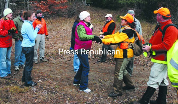 Family members (left) greeted and applauded searchers as they emerged from the woods Thursday after finding Nancy Foster, who had been missing since Wednesday.<br><br>(Staff Photo/Alvin Reiner)