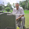 Joe Lamantia kneels at the headstone memoralizing his youngest daughter, Luciana, and her only son, Franky Davey, at St. Bernard's Cemetary. Both were killed in a September 2008 arson at their home.<br><br>(P-R Photo/Andrew Wyatt)