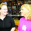 Vanessa Staples, owner of Cocktails in Morrisonville, and Juliann Carter will be holding a benefit for Toys for Kids Sunday. The event begins at noon, featuring bands, an auction and craft sale. Those interested are asked to make a donation or bring a packaged toy to help area children this holiday season. <br><br>(Staff Photo/Kelli Catana)