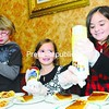 Abigail Quinn, 8; Quin Crippen, 5; and Sara Crippen, 8, all of Plattsburgh, prepare the pies with whipped cream at the Salvation Army's annual Community Thanksgiving Dinner. <br><br>(Staff Photo/Kelli Catana)