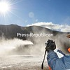 A bright sun shines down on Jon Lundin of the Olympic Regional Development Authority as he takes a snap-shot of snowmaking machines on Whiteface Mountain. Whiteface will open today with about five trails ready.<br><br>(P-R Photo/Jack LaDuke)