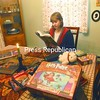 """Colleen Duniho, 15, flips through one of her """"Harry Potter"""" novels at home in Plattsburgh, surrounded by books, games and collectibles. She is self-proclaimed fanatic of all things Harry Potter and is excited to see the new movie release of """"Harry Potter and the Deathly Hollows: Part I.""""<br><br>(P-R Photo/Andrew Wyatt)"""