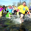 """Plattsburgh Mayor Donald Kasprzak leads the pack as the first wave of people descend into Lake Champlain for the first ever Plattsburgh """"Polar Plunge."""" View bonus photos from this event in the galleries at www.pressrepublican.com.<br><br>(P-R Photo/Gabe Dickens)"""