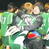 Teammates swarm Malone keeper Ben Honahan after his game-winning save in the Section X Class A boys' soccer championship game. Malone and Massena were knotted at 1-1 through regulation and overtime, and the Huskies prevailed in penalty kicks.<br><br>(P-R Photo/Pat Hendrick)