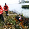 Champlain Valley Search and Rescue workers Susan Wells (left) and Patty Warrington, along with Cash, a German shepherd trained in tracking, search the shores along Dickson Point Road in Plattsburgh for evidence of Francine Marcel.<br><br>(Staff Photo/Kelli Catana)