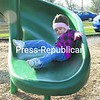 Two-year-old Hayley Wells takes a ride on a slide at the Town of Peru playground while on an outing with her Nana, Cathy Wells.<br><br>(P-R Photo/Joanne Kennedy)