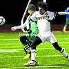 Northern Adirondack's David Miller (6) tries to keep the ball away from Seton Catholic's Christopher Kustos (4) during Wednesday night's Class C boys' soccer final. Josh Rabideau's goal gave the defending champion Bobcats a 1-0 victory.<br><br>(P-R Photo/Gabe Dickens)