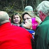 Nancy Foster (in headband) is carried by rescue workers and family from an ATV to the Elizabethtown-Lewis ambulance for transport to Elizabethtown Community Hospital. She was found Thursday morning after being missing overnight in the woods. <br><br>(Staff Photo/Alvin Reiner)