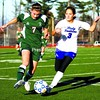 Peru's Anna Hogan (3) and Brielle Filtch of Marcellus vie for possession during a Class B regional final Saturday.<br><br>(P-R Photo/Gabe Dickens)