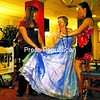 Tammy LaRock (left), an activities department leader at Meadowbrook Healthcare, and Priscilla Woolard (right), a Plattsburgh State student and member of Delta Phi Epsilon, help resident Jackie Bouchard back to her seat during the 5th annual Senior Prom at Meadowbrook Healthcare in Plattsburgh Sunday afternoon. The event, which is a favorite among many of the residents, included live music by The Castaways, 20-minute limousine rides and refreshments.<br><br>(P-R Photo/Gabe Dickens)