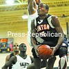 Stephane Alexander of Clinton Community College leans in against Gene Bouyea of North Country Community College to get off a shot in the first half Thursday in the first meeting of the season between the neighboring schools. Clinton CC won  81-74.<br><br>(P-R Photo/Pat Hendrick)
