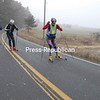 Peru residents Jim Kobak (front), Chris Rose and Mike White prepare for the upcoming cross-country ski season as they roller ski on a country road in Harkness.<br><br>(P-R Photo/Joanne Kennedy)