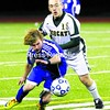 Northern Adirondack's Cameron Garrand (18) battles Schoharie's Trevor Norman for the ball Tuesday in Class C boys' soccer regional action at Plattsburgh High. Schoarie ousted NAC, 1-0, to advance to a meeting with Madrid-Waddington this weekend. Bonus photos will be available at midday at www.pressrepublicanphotos.com.<br><br>(P-R Photo/Gabe Dickens)