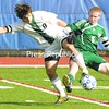 Daniel Kraynak of Hamilton (left) and Kaleb Snide of Chazy battle for the ball near the end of the first half of the NYSPHSAA Class D boys' soccer championship game at Middletown High School Sunday.<br><br>(P-R Photo/Pat Hendrick)