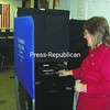 Franklin County Board of Elections Commissioner Veronica King shows the privacy and instruction improvements made to the ballot scanner. <br><br>(Staff Photo/Denise A. Raymo)