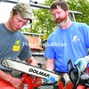 Zak and Mark Saulsgiver discuss strategies during a practice session before participating in the National Game of Logging Competition. Zak finished first, and his father placed fifth. <br><br>(Staff Photo/Alvin Reiner)