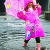 Kya Vito, 4, of Plattsburgh splashes down South Catherine Street in her rain gear Thursday. The rain that started then is supposed to continue into today, and the National Weather Service has issued flood warnings. See story, Page A5.<br><br>(Staff Photo/Kelli Catana)