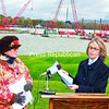 With construction of the new bridge taking place behind them, Crown Point Town Supervisor Bethany Kosmider (right) reads a resolution of support and thanks from Essex County to the Lake Champlain Bridge Coalition. Coalition President Karen Hennessy is at left. An observance was held Saturday for the old Champlain Bridge, closed one year ago.<br><br>(Staff Photo/Lohr McKinstry)