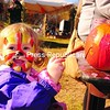 Annie Manion, 2, of Plattsburgh finishes painting a pumpkin at the annual Pumpkinfest on Mount Pisgah in Saranac Lake Saturday. The colorful event was staged to raise money for North Country Life Flight's emergency air service.<br><br>(P-R Photo/Jack LaDuke)