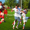 Plattsburgh State's John LoGuirato (14) defends on a St. Lawrence corner kick as the ball deflects to the Saints' Mike Manfredi Wednesday. The Saints won, 2-1, in overtime. Bonus photos will available at www.pressrepublicanphotos.com.<br><br>(P-R Photo/Andrew Wyatt)