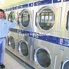 Michael Racine shows off the new dryers at Washland on Weed Street, which has finally recovered after a devastating fire.<br><br>(P-R Photo/Bruce Rowland)