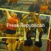 Plattsburgh High's Olivia Harrigan (12) battles Beekmantown's Jenna Brault (left) and Krysten Koktowski im CVAC volleyball action Tuesday in Beekmantown. PHS swept the match. <br><br>(P-R Photo/Andrew Wyatt)