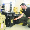 Justin Stearns, owner of Mac's Locksmith in Plattsburgh, opens an American Security safe, mostly used in homes, in his shop located on Sharron Avenue.<br><br>(Staff Photo/Kelli Catana)