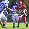 Saranac's Dylan Everleth (22) prepares to make a move against a Peru defender Oct. 9. Everleth and the Chiefs can secure the team's first home playoff game in program history with a win over Beekmantown.<br><br>(P-R Photo/Gabe Dickens)